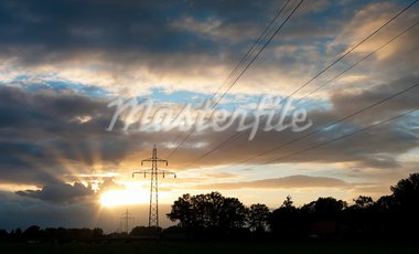 electricity pylons against a nice yellow orange sunset Stock Photo - Royalty-Free, Artist: hansenn                       , Code: 400-05697052