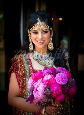 Image of a smiling Indian bride holding bouquet Stock Photo - Royalty-Free, Artist: gregory21                     , Code: 400-05697308