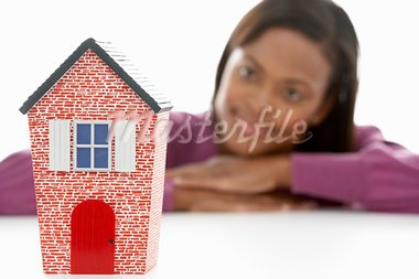 Woman Looking At Model House Stock Photo - Royalty-Free, Artist: MonkeyBusinessImages          , Code: 400-05697462