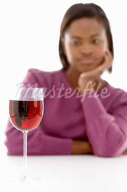 Woman Looking At Glass Of Wine Stock Photo - Royalty-Free, Artist: MonkeyBusinessImages          , Code: 400-05697465