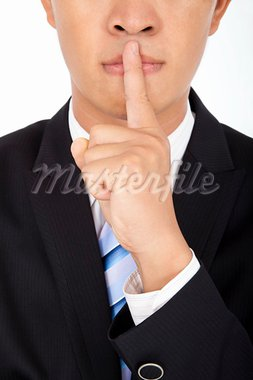 businessman showing quiet gesture with his finger Stock Photo - Royalty-Free, Artist: tomwang                       , Code: 400-05698886