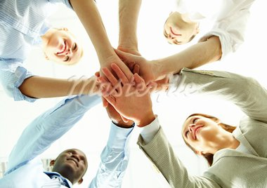 Four business people putting their hands on hands of their colleagues Stock Photo - Royalty-Free, Artist: pressmaster                   , Code: 400-05699607