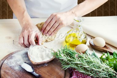 Woman is kneading dough balls. Stock Photo - Royalty-Free, Artist: mythja                        , Code: 400-05701403