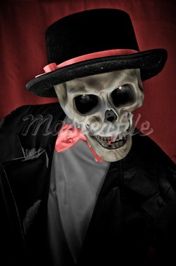 Skeleton in suite portrait on red background. Stock Photo - Royalty-Free, Artist: dmitryelagin                  , Code: 400-05704275