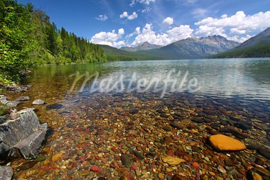 Brightly colored rocks seen through the crystal clear waters of Kintla Lake in Glacier National Park - USA. Stock Photo - Royalty-Free, Artist: Wirepec                       , Code: 400-05705132