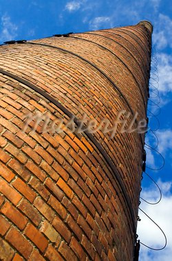 Huge brick chimney under blue sky - low perspective Stock Photo - Royalty-Free, Artist: ximinez                       , Code: 400-05705355