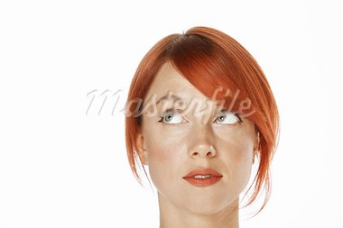 close-up shot of a caucasian beautiful woman. Looking up to the side Stock Photo - Royalty-Free, Artist: fotum                         , Code: 400-05705593