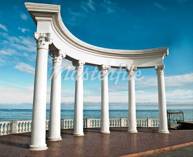 Ancient Greek columns against a blue sky and sea Stock Photo - Royalty-Free, Artist: GekaSkr                       , Code: 400-05705960