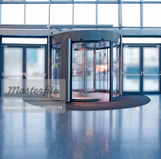 Revolving door in reception of office building Stock Photo - Crestock Royalty-Free, Artist: PinkBadger                    , Code: 400-05706066