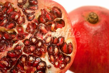 Close up of red pomegranate with seeds Stock Photo - Royalty-Free, Artist: PinkBadger                    , Code: 400-05706070