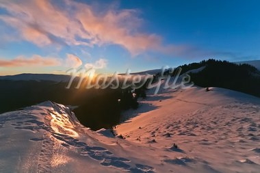 reflection of sun on snow at sunset Stock Photo - Royalty-Free, Artist: porojnicu                     , Code: 400-05708299