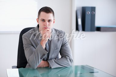 Thinking businessman sitting behind a table Stock Photo - Royalty-Free, Artist: 4774344sean                   , Code: 400-05709554