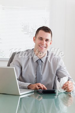 Happy young businessman checking an invoice Stock Photo - Royalty-Free, Artist: 4774344sean                   , Code: 400-05709651