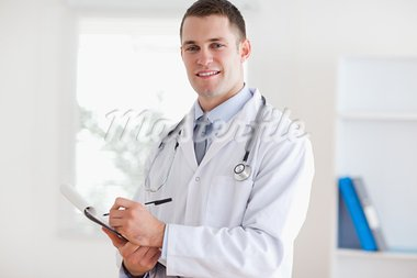Smiling doctor listening and taking notes Stock Photo - Royalty-Free, Artist: 4774344sean                   , Code: 400-05710405