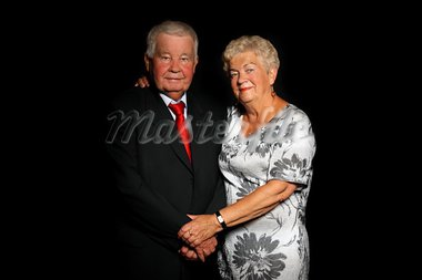 A portrait of a beautiful senior couple standing together over black background Stock Photo - Royalty-Free, Artist: macniak                       , Code: 400-05710447