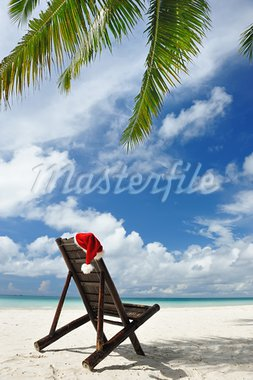 Santa's hat and chaise lounge on the beach Stock Photo - Royalty-Free, Artist: haveseen                      , Code: 400-05711607