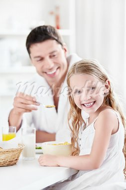 A girl eating breakfast with his father Stock Photo - Royalty-Free, Artist: Deklofenak                    , Code: 400-05711777