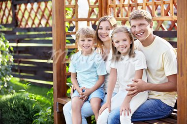 Smiling family in the gazebo outdoors Stock Photo - Royalty-Free, Artist: Deklofenak                    , Code: 400-05711855