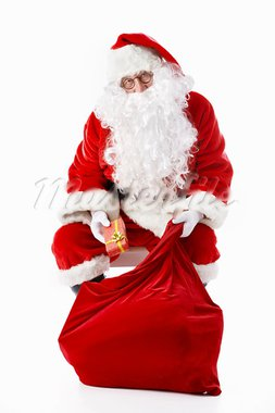 Santa Claus gets a gift bag of Stock Photo - Royalty-Free, Artist: Deklofenak                    , Code: 400-05711905