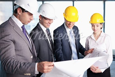 Business people in hard hats at construction site Stock Photo - Royalty-Free, Artist: Deklofenak                    , Code: 400-05711964