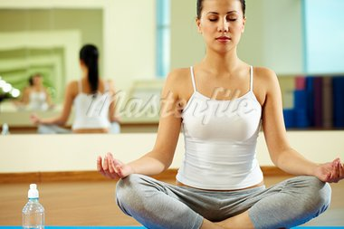 Portrait of serene girl doing yoga exercise in gym Stock Photo - Royalty-Free, Artist: pressmaster                   , Code: 400-05712037