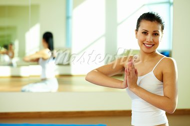 Portrait of happy girl during yoga practice in gym Stock Photo - Royalty-Free, Artist: pressmaster                   , Code: 400-05712045