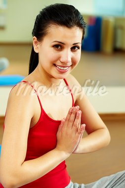 Portrait of happy girl meditating in gym Stock Photo - Royalty-Free, Artist: pressmaster                   , Code: 400-05712062