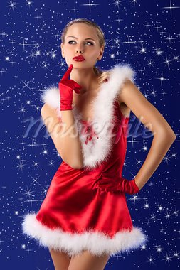 young and sexy woman in red santa claus dress, white fur and gloves Stock Photo - Royalty-Free, Artist: carlodapino                   , Code: 400-05713404