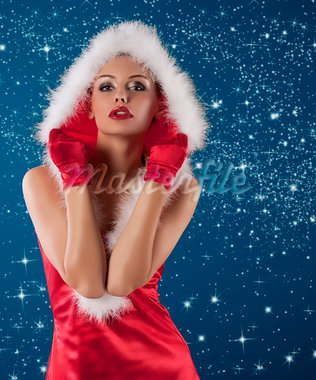 young and sexy woman in red santa claus dress with hood and white fur and gloves Stock Photo - Royalty-Free, Artist: carlodapino                   , Code: 400-05713406
