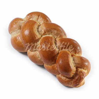 Photo of an isolated loaf of traditional Swiss bread called Butterzopf over white background.  Shadow visible underneath. Stock Photo - Royalty-Free, Artist: sumners                       , Code: 400-05713907