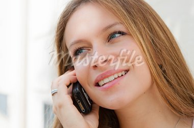 Outdoor portrait young woman talk on a cellular telephone Stock Photo - Royalty-Free, Artist: ilolab                        , Code: 400-05714292
