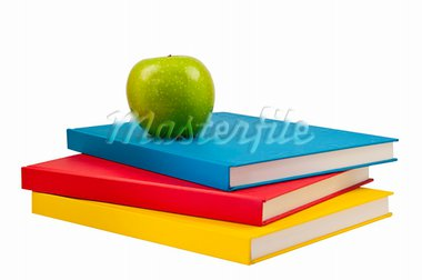 Three books with a green apple on top.This has a clipping path. Stock Photo - Royalty-Free, Artist: crestockfrank                 , Code: 400-05714638