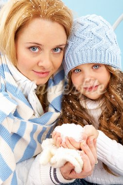 Portrait of mother and her daughter in winter clothes looking at camera Stock Photo - Royalty-Free, Artist: pressmaster                   , Code: 400-05714723