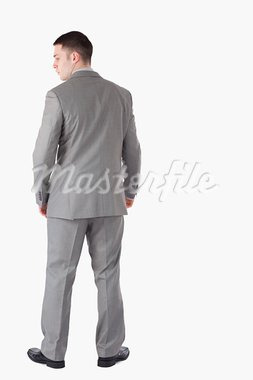 Portrait of a businessman turning his back against a white background Stock Photo - Royalty-Free, Artist: 4774344sean                   , Code: 400-05714866