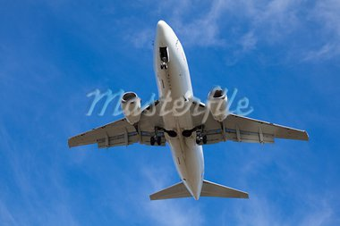 airplane landing on the blue sky background Stock Photo - Royalty-Free, Artist: Koljambus                     , Code: 400-05715155