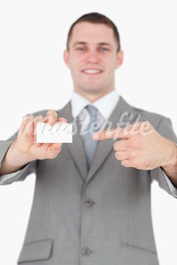 Portrait of a young businessman pointing at a blank business card against a white background Stock Photo - Royalty-Free, Artist: 4774344sean                   , Code: 400-05715167