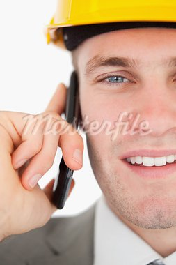 Close up of a smiling architect making a phone call against a white background Stock Photo - Royalty-Free, Artist: 4774344sean                   , Code: 400-05715193
