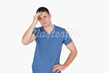 Young man having a headache against a white background Stock Photo - Royalty-Free, Artist: 4774344sean                   , Code: 400-05715259