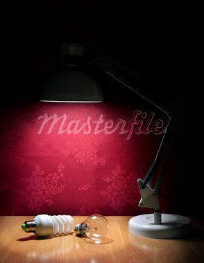 Ecologic light bulbs sitting on table and illuminated by lamp Stock Photo - Royalty-Free, Artist: silent47                      , Code: 400-05715877