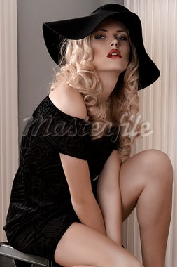 pretty young woman with sensual red lips dressed with a black dress and a huge hat Stock Photo - Royalty-Free, Artist: carlodapino                   , Code: 400-05716857