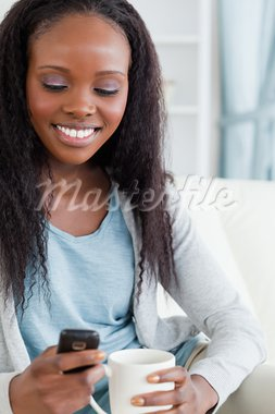 Close up of smiling woman texting Stock Photo - Royalty-Free, Artist: 4774344sean                   , Code: 400-05717105