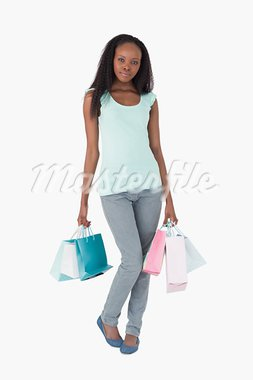 Young woman with her shopping on white background Stock Photo - Royalty-Free, Artist: 4774344sean                   , Code: 400-05717285