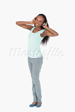 Smiling woman enjoying music with headphones on white background Stock Photo - Royalty-Free, Artist: 4774344sean                   , Code: 400-05717301