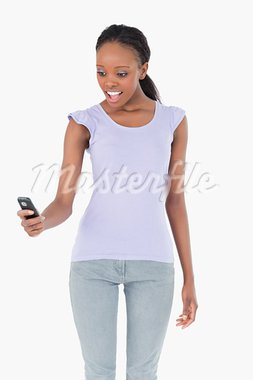 Close up of young woman being surprised by text message on white background Stock Photo - Royalty-Free, Artist: 4774344sean                   , Code: 400-05717347