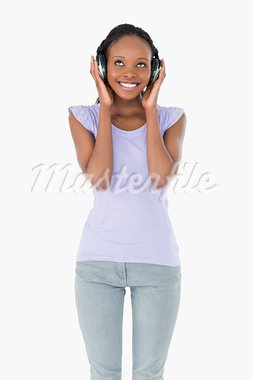 Close up of happy young woman enjoying music on white background Stock Photo - Royalty-Free, Artist: 4774344sean                   , Code: 400-05717359