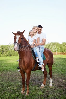 A family on a horse Stock Photo - Royalty-Free, Artist: Deklofenak                    , Code: 400-05717409