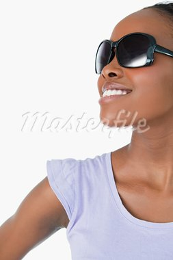 Close up of smiling woman wearing sunglasses on white background Stock Photo - Royalty-Free, Artist: 4774344sean                   , Code: 400-05717457