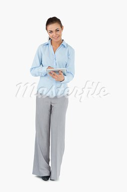 Smiling businesswoman with tablet against a white background Stock Photo - Royalty-Free, Artist: 4774344sean                   , Code: 400-05718168