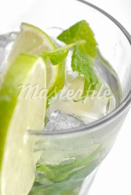 Closeup of lime in a glass of mojito with ice Stock Photo - Royalty-Free, Artist: gorgev                        , Code: 400-05718910