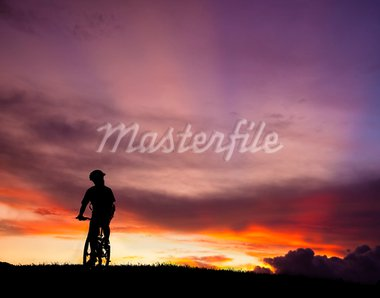 The silhouette of mountain bicycle rider on the hill with beautiful sunrise background Stock Photo - Royalty-Free, Artist: tomwang                       , Code: 400-05718933